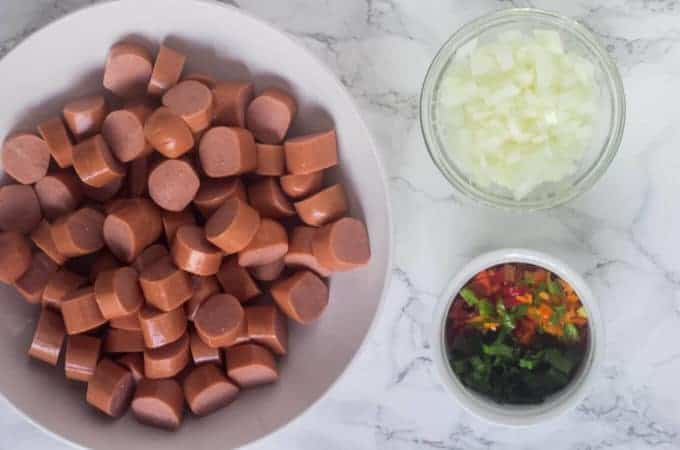 diced sausage, onion, sweet pepper and culantro leaves