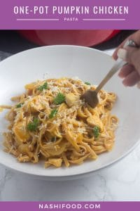 a plate with pumpkin chicken pasta served.